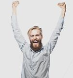 Bearded man showing hand up. Life style, happiness and people concept: young positivity  bearded man showing hand up standing against grey background Royalty Free Stock Images