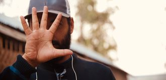 Man showing his hands and fingers. A bearded man showing his hands with five fingers isolated unique photo stock photography