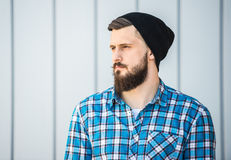 Bearded man. Side view  of bearded man in hat outdoor Stock Images