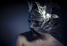 Bearded man with silver mask Venetian style. Mystery and renaiss Royalty Free Stock Images