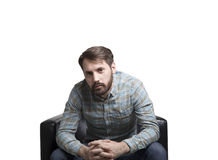 Bearded man sitting in an armchair Stock Photos