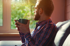Bearded man sitting with cup of coffee Royalty Free Stock Photo