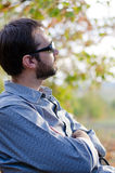 Bearded man sitting enjoying Royalty Free Stock Photo