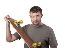 Bearded man with skateboard Royalty Free Stock Images