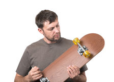 Bearded man with skateboard Stock Images