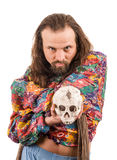 The bearded man with a skull. The bearded man in the colour shirt with a skull in his hands isolated on white Stock Photography