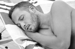Bearded man sleeping  at the beach Royalty Free Stock Photography