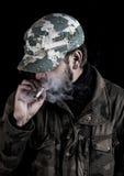 Bearded man smokes a cigarette in Finland. Stock Photos