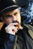 Bearded man smoking cigar Royalty Free Stock Images