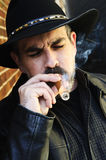 Bearded man smoking cigar Stock Images