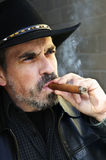 Bearded man smoking cigar Royalty Free Stock Image