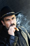 Bearded man smoking cigar Stock Photo
