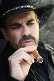 Bearded man smoking cigar Royalty Free Stock Photography