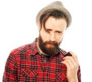 Bearded man smoking a pipe Stock Image