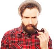 Bearded man smoking a pipe Royalty Free Stock Photo