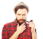 Bearded man smoking a pipe Stock Images