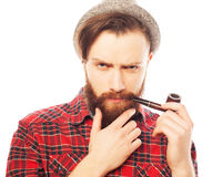 Bearded man smoking a pipe Stock Photos
