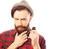Bearded man smoking a pipe Stock Photo