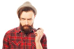 Bearded man smoking a pipe Stock Photo