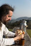 Bearded man is snacking in the nature Royalty Free Stock Photo