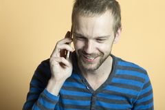 Bearded man speaking to someone on the phone stock photography