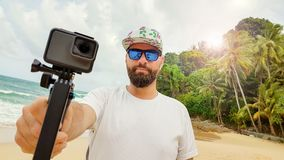 Bearded man with sport camera Royalty Free Stock Photo