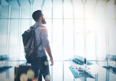 Bearded man standing at the airport hall with a Royalty Free Stock Images