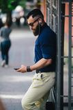 Bearded man standing and listening to music Royalty Free Stock Photos