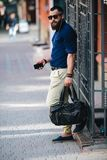 Bearded man standing and listening to music Royalty Free Stock Photography