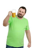 Bearded chap staring at lager mug. White bearded chap in green t-shirt staring at lager mug on white background Royalty Free Stock Photo