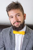 Bearded man in a suit and bow tie Stock Photography