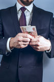 Bearded man in suit holds Russian rubles Royalty Free Stock Photography