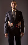 A bearded man in a suit and the woman& x27;s hand. Royalty Free Stock Photos