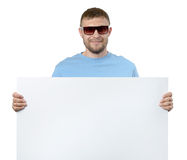 Bearded man in sun glasses holding white billboard Royalty Free Stock Photo
