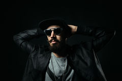 The bearded man in a sunglasses clasped his hands behind his hea Stock Photo