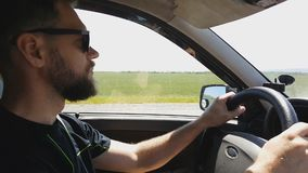 Bearded man in sunglasses driving , travel by car. stock video footage