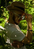 Bearded man in sunglasses and a hat Stock Image