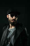 The bearded man with sunglasses looking away Royalty Free Stock Photo