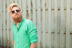 Bearded man with sunglasses looking up Royalty Free Stock Photography