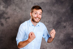 Bearded man is surprised and showing open hands royalty free stock images