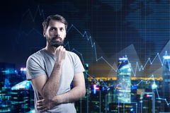Bearded man in T-shirt and night city Stock Photos