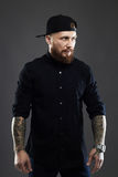 Bearded man with tattoo Stock Images