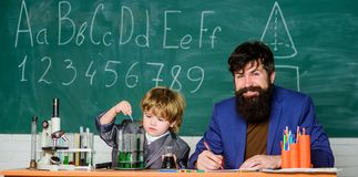 Bearded man teacher with boy. Science chemistry concept. confidence charisma. Back to school. father son at school. Bearded men teacher with boy. Science stock image