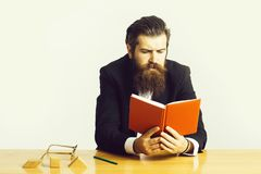Bearded man teacher at table royalty free stock images