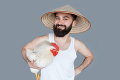 Bearded man thailand tourist posing with white chicken royalty free stock photo