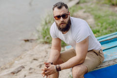 Bearded man on thebeach Stock Images