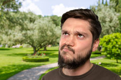 Bearded man thinking deeply Royalty Free Stock Images