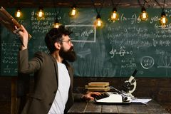 Bearded man throw briefcase. Man with beard typewrite research paper. Businessman in suit work at desk. Scientist in. Glasses with microscope and books. Future stock image