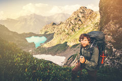 Bearded Man Traveler with backpack hiking. Travel Lifestyle concept lake and mountains on background Summer adventure vacations outdoor royalty free stock images