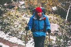 Bearded Man Traveler hiking alone in forest. With action camera on backpack Travel Lifestyle adventure survival concept outdoor active vacations stock photography